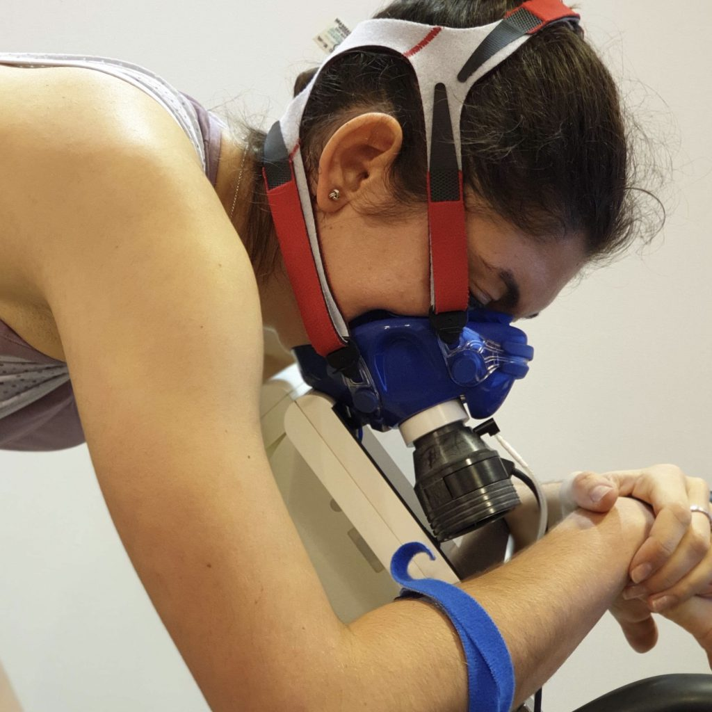 Cyclist wearing VO2 Max test mask and sweat collecting wrist band