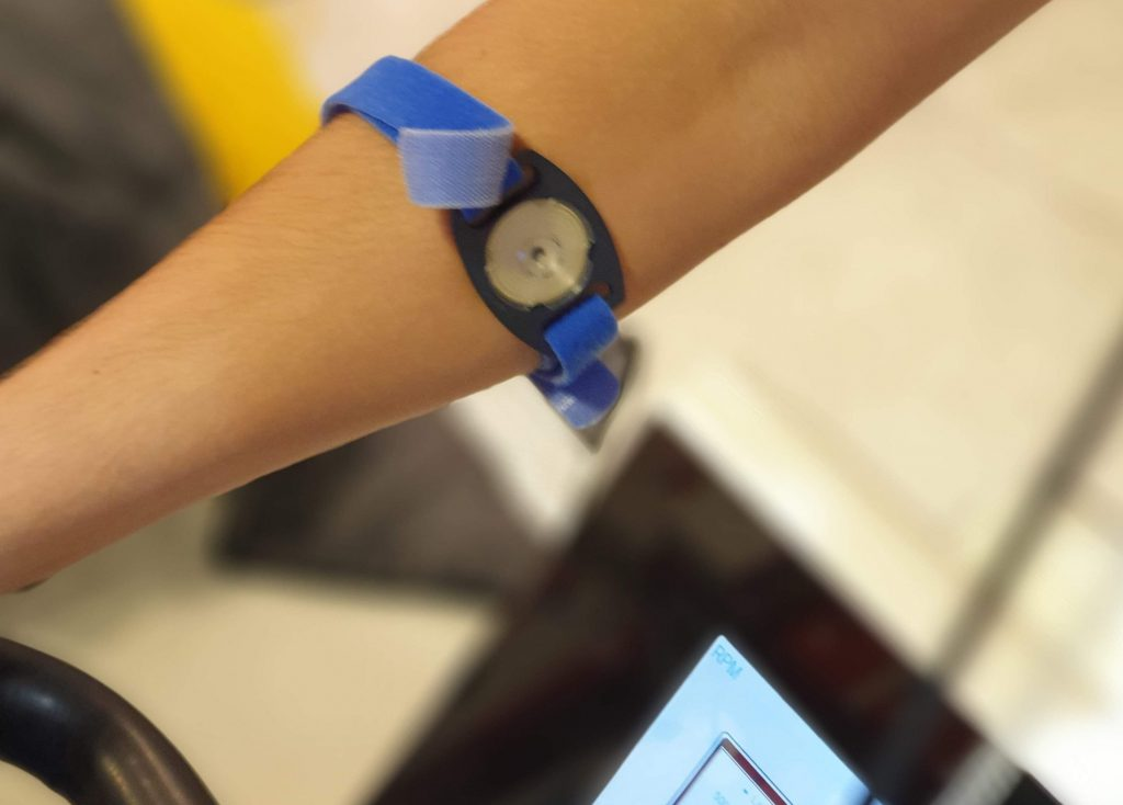 Image showing sweat collector band on the lower arm of a cyclist in the lab